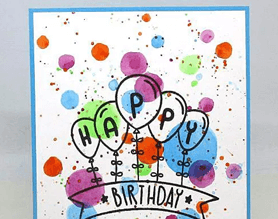 Handmade happy birthday card with paint splatter and balloons
