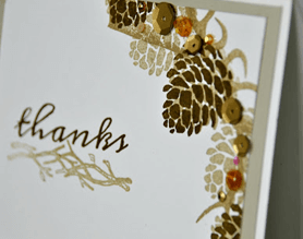 Rustic thank you card with pine cones and a thank you stamp