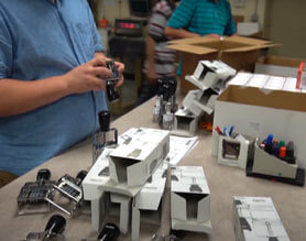 Production image of stamps being assembled